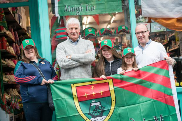 Flying the flag: Imelda Hunt and Willie Joe Padden with Chris Heneghan and his daughters Naoise and Chloe in Castlebar, Co Mayo. Photo: Keith Heneghan / Phocus