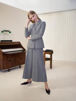 Houndstooth jacket, €2,980; matching trousers, €1,300, both Christian Dior; mules, €525, Balenciaga