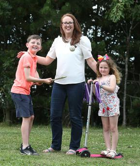 Right on schedule: Jennifer Casey with her kids Matthew (9) and Isabelle (5). Photo: Damien Eagers