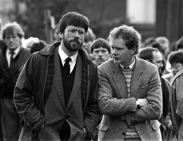 Double act: Adams and McGuinness (right) at the funeral of IRA commander Patrick Kelly (30) in 1987. Photo: PA Wire