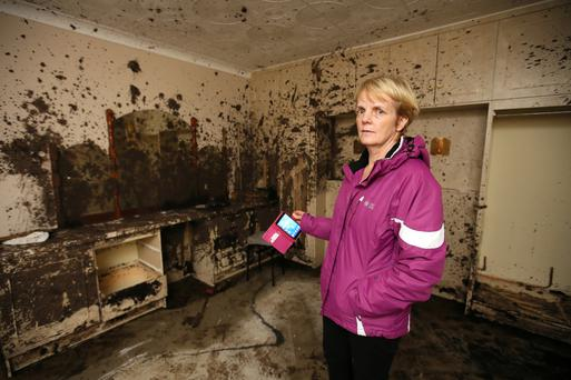 Bernie Kearney in her bedroom which was destroyed after a mudslide crashed through her bedroom wall during the heavy rains and flooding at Urris Mannagh, Co Donegal. Photo: Frank Mc Grath