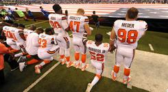 United state: Players from the Cleveland Browns kneel and link arms during the national anthem ahead of their game at the weekend. Photo: Thomas J/USA Today Sports