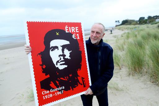 Jim Fitzpatrick, the artist behind the iconic Che Guevara image, with the new An Post stamps bearing his design. Photo: Maxwells
