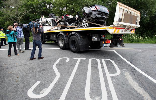 Tragedy: The Volkswagen Passat, in which seven friends were killed, is removed from the crash scene on July 12, 2010, in Donegal. It is the worst single road-traffic crash in Ireland's history. Photo: Paul Faith/ Inset Photos: North West Newspix