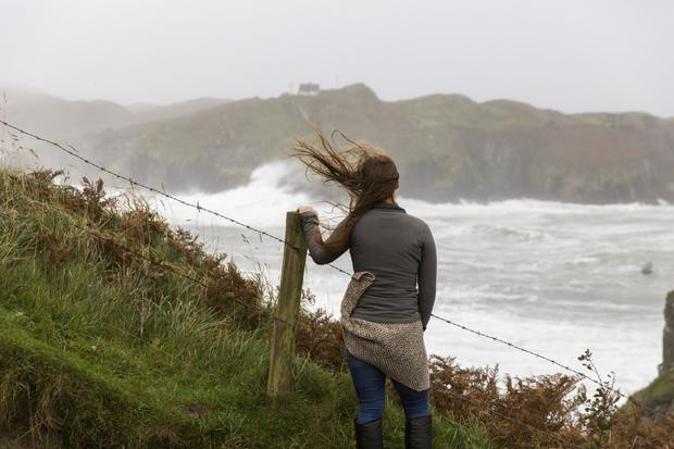 Weathering the storm: An onlooker watches as Ophelia takes hold in Baltimore, west Cork. Photo: Emma Jervis Photography