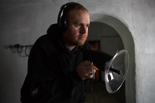 Dominic McElroy (Lead Investigator) uses a parabolic dish to pick up low frequency sounds in the dungeons