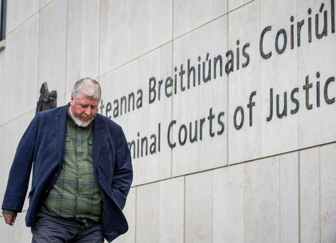Public shame: Tom Humphries leaving the Criminal Courts of Justice during his trial. Photo: Douglas O'Connor