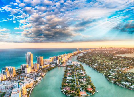 Miami Beach is connected by bridges to mainland Miami. Spring breakers party and everyone is impossibly attractive.