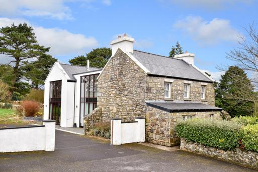Carraroe is a traditional stone farmhouse with a modern extension.