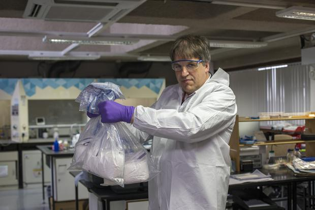 Pure facts: Journalist Kim Bielenberg with bags of the suspected drug. Photo: Mark Condren