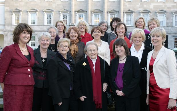 Tribute: Joan Burton (left) in 2008 with Labour deputies and senators, past and present, at an event to commemorate the 90th anniversary of the 1918 election, the first in which women had the right to vote, and in which Countess Markiewicz was elected as the first woman TD and MP. Photo: Tom Burke