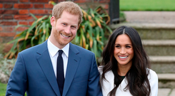Wedding belle: Prince Harry and Meghan Markle show off her engagement ring. Photo: Chris Jackson/Getty Images