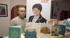 Arlene Foster's constituency worker, Brian Hazlet, pictured with thank you cards in her office for her stance on the Brexit deal. Photo: Mark Condren