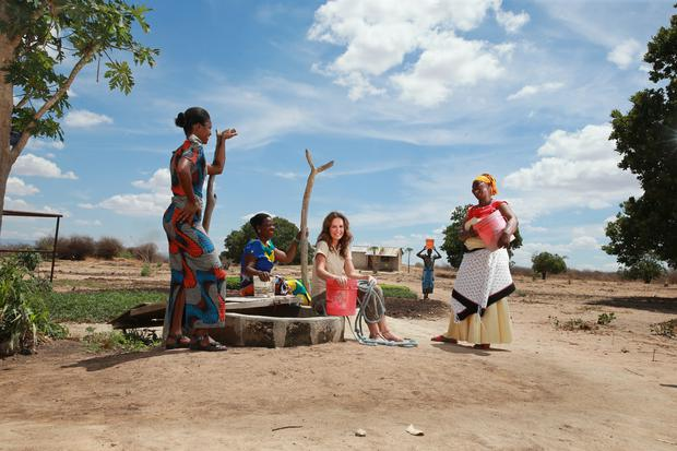 Lorraine with women from the Upendo Group at the local well in Mundemu village