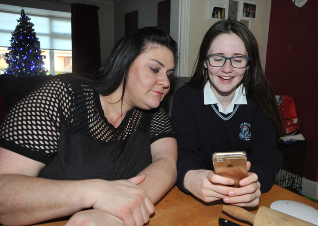 Parental guidance: Vivienne Lyons checks her daughter Aimee's phone. Photo: Seamus Farrelly