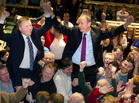 Celebration: Michael McGrath and Micheál Martin are elected on the first count at City Hall, Cork, in February 2016, with McGrath polling more votes than his leader. Photo: Tony Gavin