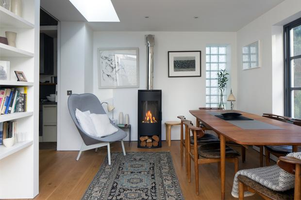 The Vaska stove is actually gas, and so the collection of logs is a touch of irony. Clodagh says it makes a huge difference to the warmth of the apartment. The Uchiwa chair is from Inreda, and Clodagh bought the Kurdish rug in London in the 1980s.