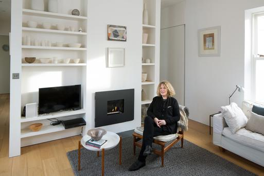 Architect Clodagh Nolan in her sitting room, with its subtle palette of whites and greys.
