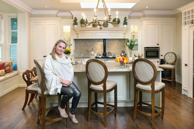 Tahnee in her kitchen/dining room, which spans the back of the house. It was cleverly extended by her sister Karen's husband, Michael Healy of Gem Construction. Karen is an interior designer and she helped Tahnee with colours, curtains and cushions, many of which she sourced in Bushfield Interiors in Dunleer