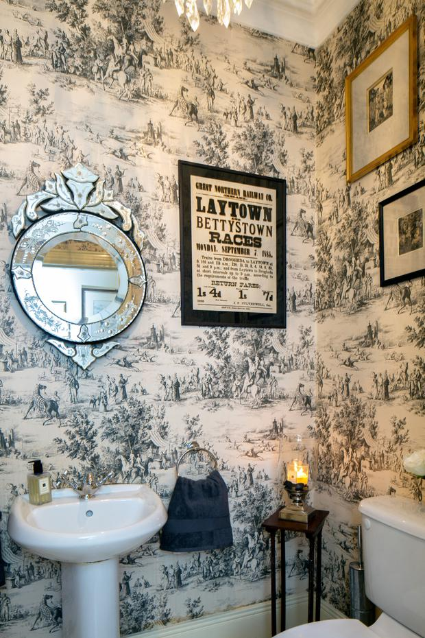 The downstairs toilet is given a touch of luxury with the addition of toile de Jouy wallpaper. The mirror was a wedding present