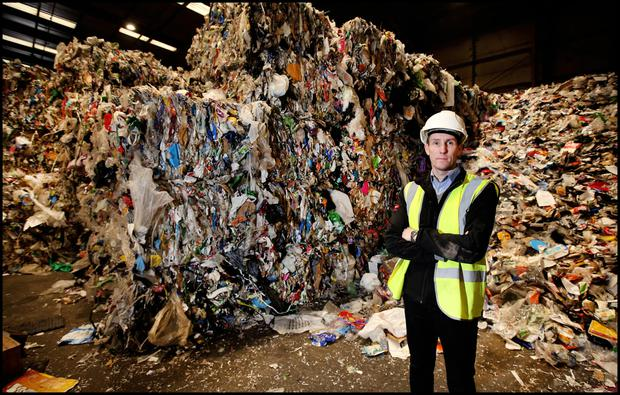 Waste mountain: David Duff, who is environmental, health and safety manager at the Thorntons Recycling Plant at ParkWest Business Park in Dublin. Photo: Steve Humphreys