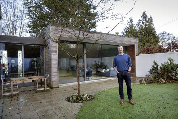 Paul in the courtyard. The sunroom is behind him, with the hall to his right. The kitchen/living/dining is at right angles to that part of the build