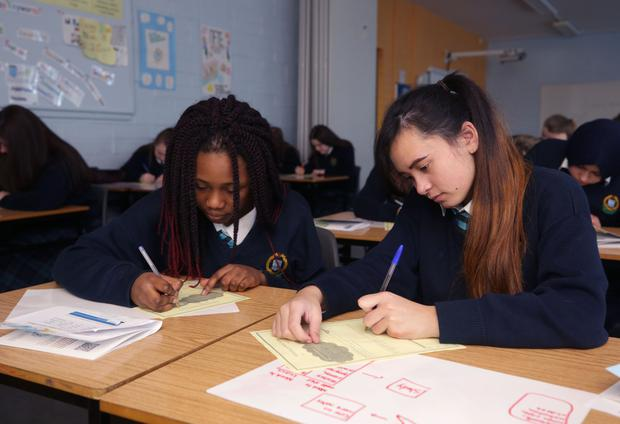 Third-year students Jennifer Anago (14), left, and Maia Kridichart (15) studying in Colaiste Bride secondary school, Clondalkin. Photo: Damien Eagers
