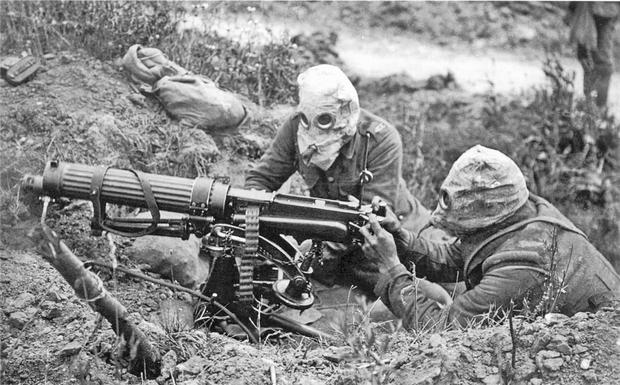A Vickers machine gun crew in anti-gas helmets near Ovillers on the Somme, July 1916.