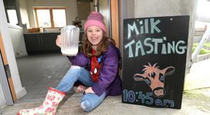 Got milk: Lois Caffrey tries unhomogenised milk at Airfield Farm in Dundrum, Dublin. Photo: Justin Farrelly