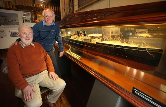 U-boat attack: Brian Ellis, right, honorary librarian at the National Maritime Museum, and author Philip Lecane beside a model of the RMS Leinster in the Dún Laoghaire museum. Photo: Damien Eagers
