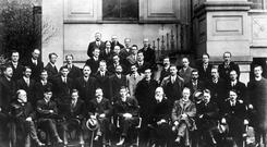 Young guns: Some of the Sinn Féin leaders at the First Dail Éireann following the December election. Many elected members were still in jail. The front row here, from left: L Ginnell, Michael Collins, Cathal Brugha, Arthur Griffith, Éamon de Valera, Count Eoin MacNeill, William Cosgrave and Ernest Blythe.