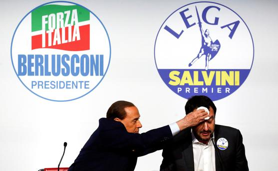 New guard: Berlusconi mops the brow of political ally Matteo Salvini during the Italian election campaign. Photo: Reuters