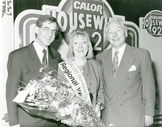 Award: Marie Cronin from Clondalkin with Terry Leonard from Calor Kosangas and host Gay Byrne after winning the Dublin Final of the Calor Housewife of the Year 1992