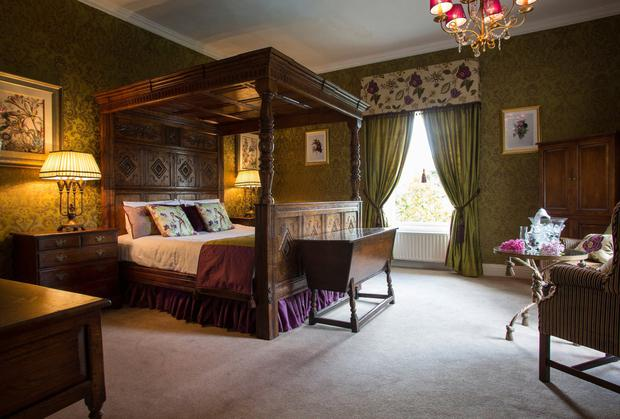 One of the four fabulous double-poster suites at Raheen House Hotel