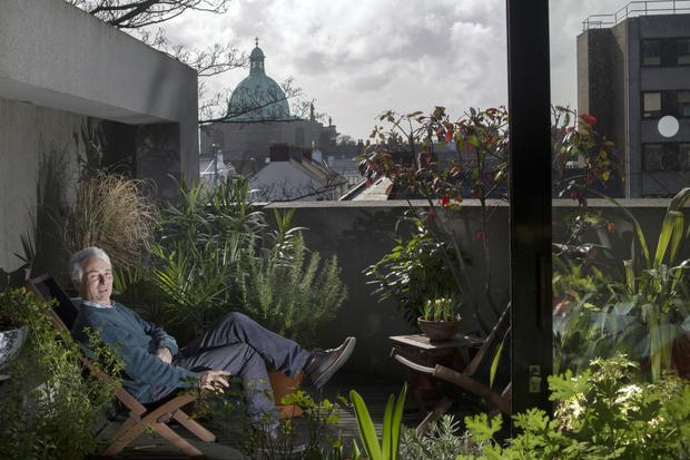 Joe on the balcony off the kitchen with its view of the copper dome of Rathmines Church