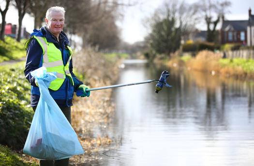 Good example: Eric Conroy picks rubbish out of the Grand Canal. Photo: Gerry Mooney