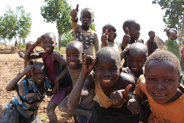 Village children from the Gulu area give the thumbs-up