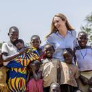 Pandora McCormick with children from a West Nile village