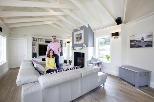 Steven and Sasha in the living room which links the kitchen area to the bedrooms. They did major work here, putting in new sash windows, raising the roof and changing the floor. As elsewhere, Steven designed and built all the units and the fire surround