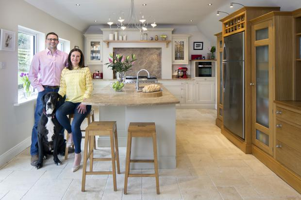 Steven Jones his wife, Sasha, and their Great Dane, Wilson, in the kitchen Steven designed and built himself over six weekends. It has really stood the test of time, though Steven says the marble worktop dates it slightly. It has two Fisher & Paykel dishwashers -