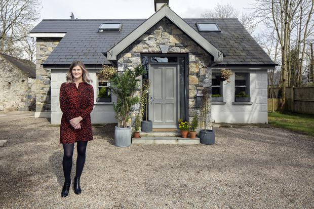 Interior designer Geri O'Toole outside the cottage dating from the 1920s, which she and and her husband Cathal renovated. On an acre of countryside, it was single storey, and while they kept the same footprint, they were able to add an upstairs. They renovated all the sash windows, using the original weights