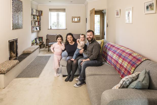 Mark and Emma in the lounge of No 7 with their children, Freya and Iris. 'We will really miss the house,' says Emma. 'It is quite quirky and has a lovely character.'