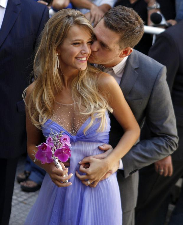 Buble and his bride Luisana Lopilato after their wedding in Buenos Aires, Argentina