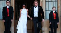 Mr & Mrs: the new Duchess of Sussex Meghan Markle sports a bespoke Stella McCartney halter-neck gown at the after party of her wedding to Prince Harry. Photo: AFP/Getty Images