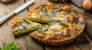 A good quiche is the backbone of a simple summer lunch or supper in the garden. Stock photo