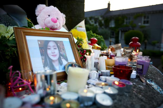 A community mourns: A shrine to Jastine Valdez in Enniskerry where candles and flowers surround a photograph of the murdered woman. Photo: Gerry Mooney
