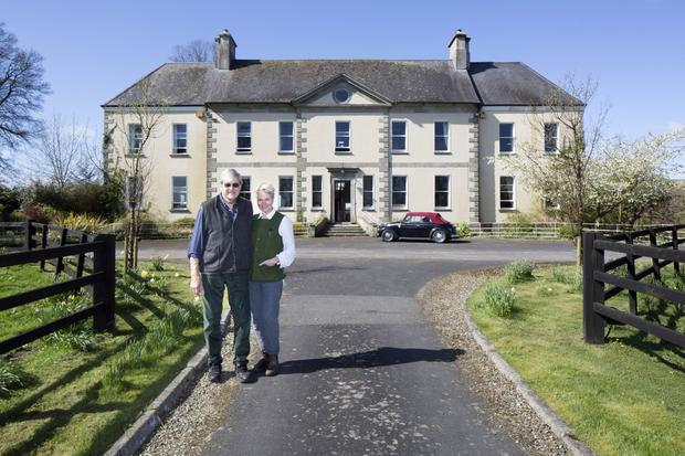 Christopher Bielenberg and Bella Huddart outside Sandbrook House, which is on 25 acres and dates from 1720. The two wings date from the 1840s.