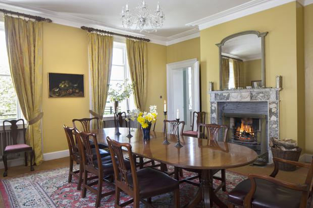 The dining table is from England, while the chairs are reproductions of chairs in Luttrellstown by Hicks of Dublin