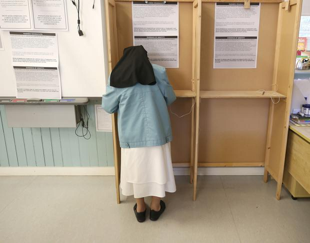 A Dominician nun votes in the Referendum on the 8th Amendment of the Irish Constitution