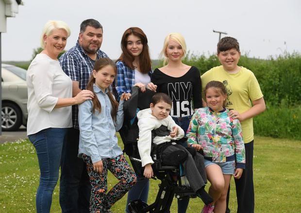 Pictured from left to right: Liz and Dave Forde with their kids Ava, Ellie, Cillian, Emer, Gwen and Kyle at home in Kerry. Photo: Domnick Walsh